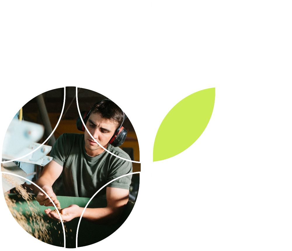 Seeds Canada logo outline over a grower holding seed.